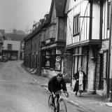 Tommy rides along the High Street, Aylesford, Kent