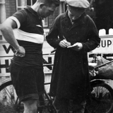A Postman checks Tommy's mileage