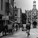 Market Cross, Chichester: Tommy rides past the clocktower en-route to another massive daily total